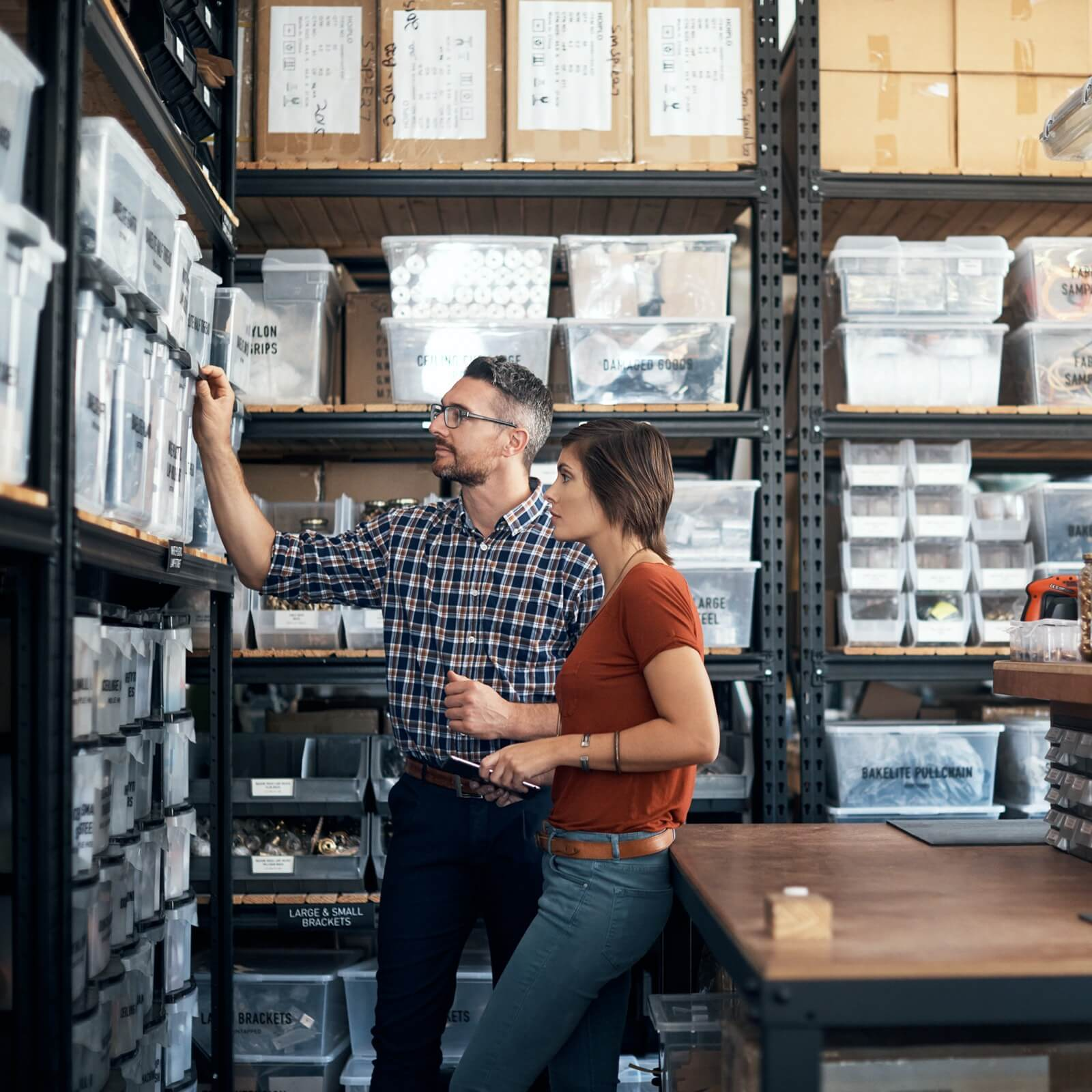 man and woman in stock room