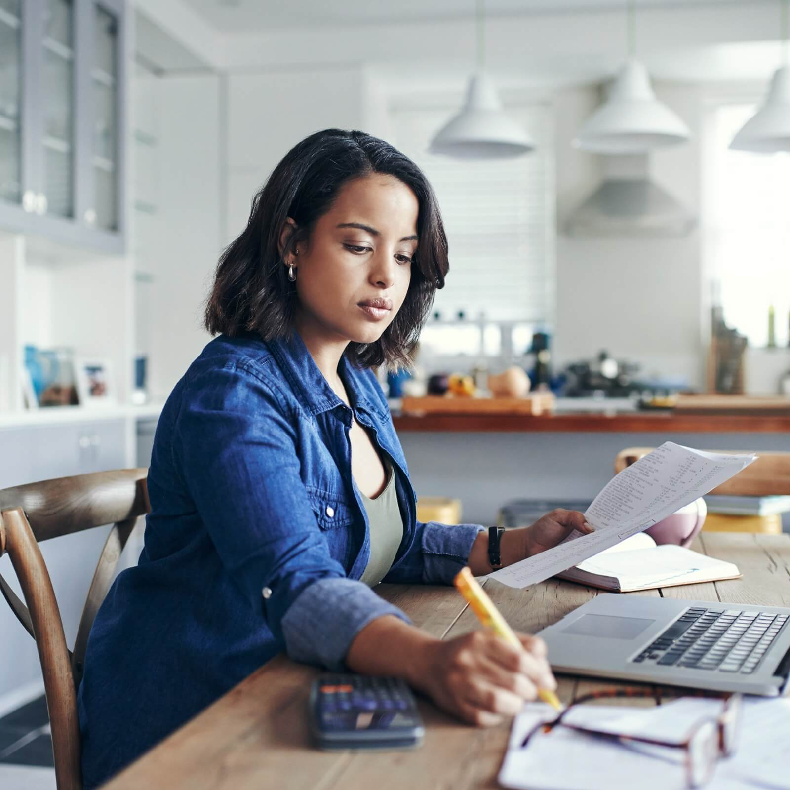 woman working at table with laptop